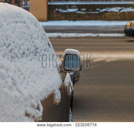 car mirror in the snow close up