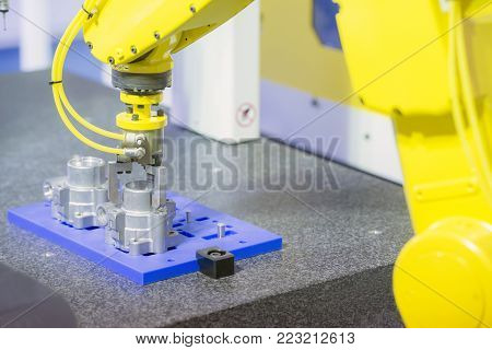 The robot arm for take the aluminium part .Industrial 4.0 concept for modern manufacturing.