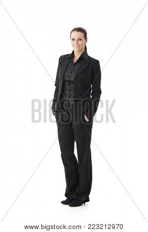 Business portrait of mid-adult woman in smart woman suit, full length, cutout on white.