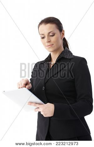 Smiling smart businesswoman using tablet pc, cutout on white, low angle view.
