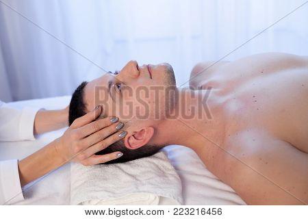 male masseur doing massage health spa procedure 1