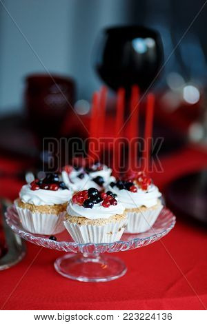 Delicious sweet buffet with cupcakes. Sweet holiday buffet with cupcakes and other desserts. Candy Bar for Valentins day.