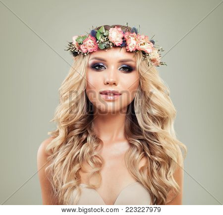 Summer Portrait of Cute Woman with Flowers and Healthy Hair. Skincare and Haircare Concept