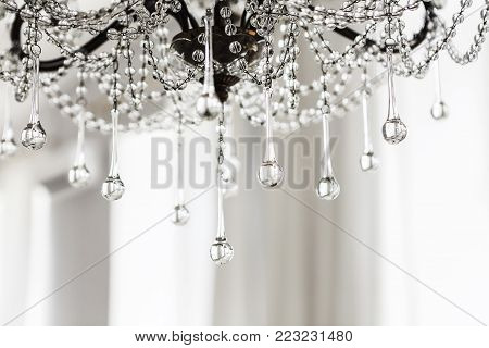 Crystal chandelier close up on white background
