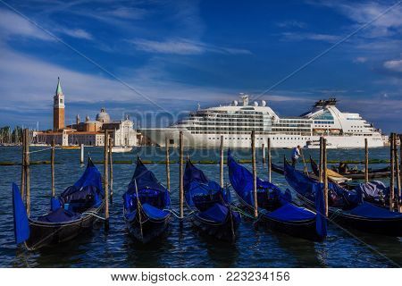 VENICE, ITALY - JUNE 18: Giant cruise ship inside Venetian Lagoon. A very big issue for the preservation of Venice fragile enviroment and city historic heritage June 18, 2016 in Venice, Italy