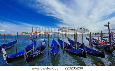 VENICE, ITALY - JUNE 19: Giant cruise ship inside Venetian Lagoon. A very big issue for the preservation of Venice fragile enviroment and city historic heritage June 19, 2016 in Venice, Italy