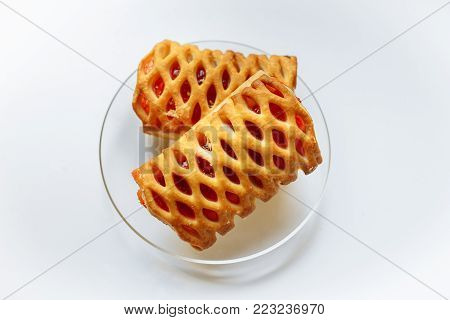 Biscuits with jam on a transparent plate on a white background