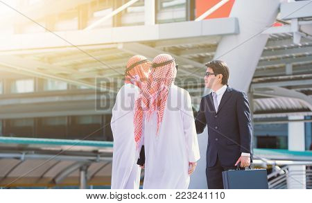 handshake concept.Arabic business and Businessman shaking hands