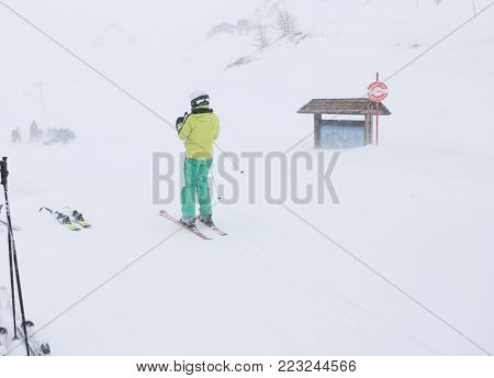 Skier in a snow blizzard on the top of the slope