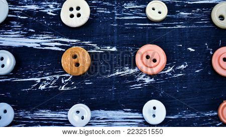 Buttons for clothing and sewing on the table.