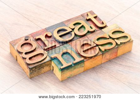 greatness word abstract in letterprtess wood type blocks stained by color inks