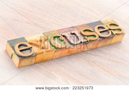 excuses word abstract in letterprtess wood type blocks stained by color inks