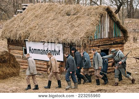 Rogachev, Belarus - February 25, 2017: Re-enactor Dressed As German Wehrmacht Infantry Soldiers Of World War II Leading Re-enactors Dressed As Russian Soviet Prisoners