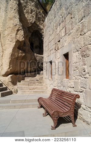 A bench near a stone wall.Tourist places and sights of Armenia. Yerevan.