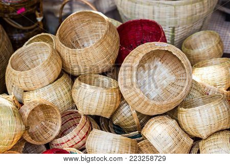 Close-up  Community Products Weaving A Wicker Basket By Handmade, in a market of Thailand
