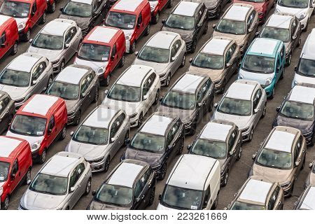 Savona, Italy - December 2, 2016: Cars ready to be shipped over sea in the cargo area at the harbour of Savona in Liguria, Italy.