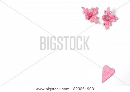 pink figurines on a white background. frame for the layout. view from above