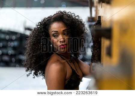 Young african descent woman in old factory face portrait