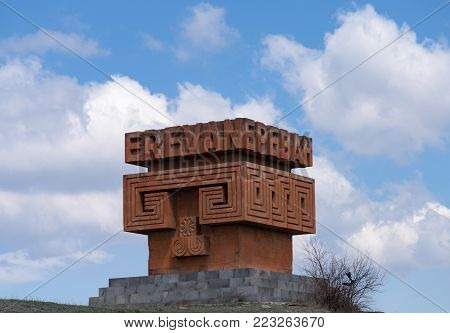 YEREVAN, ARMENIA - APRIL 3: Gigantic red stone sign / sculpture welcoming visitors to Yerevan by side of the M4 road to the north towards Sevan region April 3, 2017 in Yerevan, Armenia.