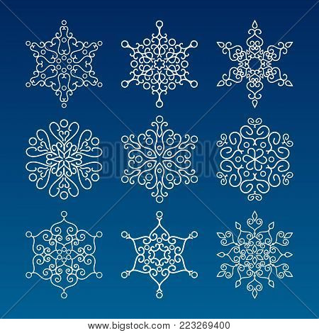 Vintage outlined snowflakes isolated. Winter icons on blue background