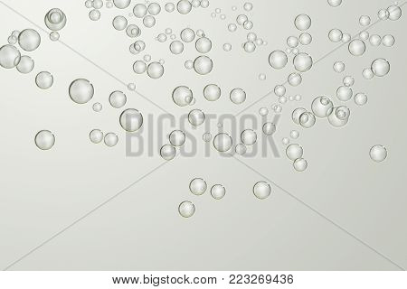 Many small fizz bubbles over a gradient surface.
