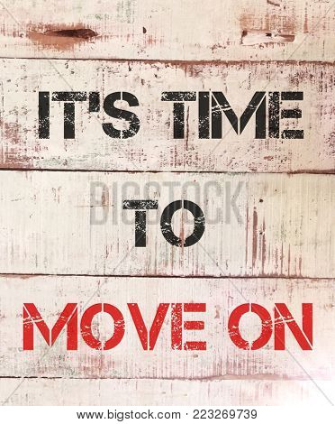 It's time to move on, written on grunge pallet wood