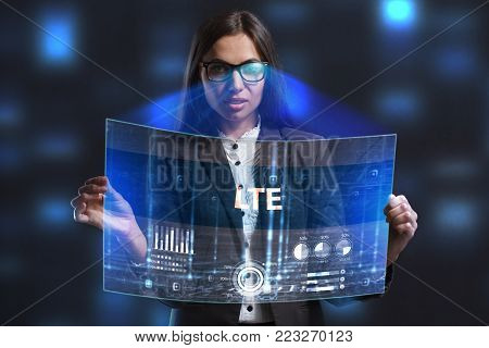 The concept of business, technology, the Internet and the network. A young entrepreneur working on a virtual screen of the future and sees the inscription: LTE