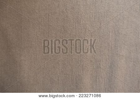 Beige simple unprinted jersey fabric from above