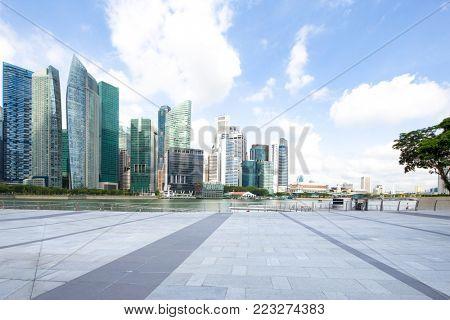 modern buildings in midtown of singapore in cloud sky from emtpy sidewalk