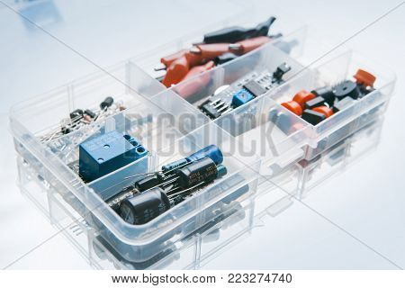 box with microelectronics elements on white background. electronics repair. construction kit