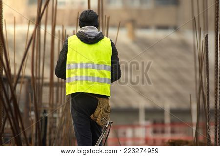 Builder in yellow at the construction site