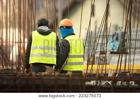 Two labours in yellow at the reconstruction area