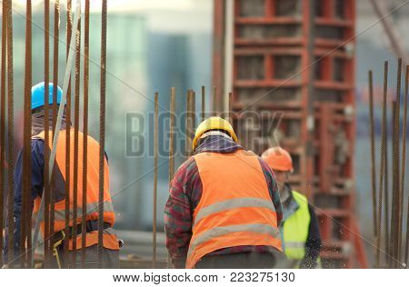 Armature and builders in orange at the reconstruction area