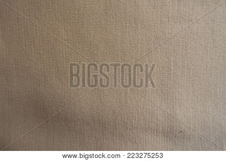 Top view of beige jersey fabric surface
