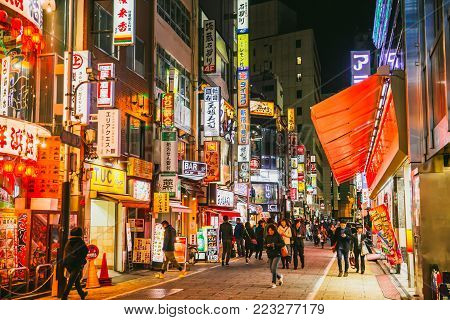 Japanese And Tourist At Shinjuku Nightlife Colorful Billboard Shopping Street Most Population Travel