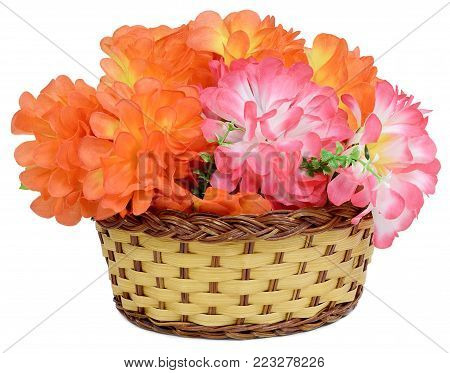 Large bouquet in a basket of Artificial flower rose peony red white yellow and orange bright color made of synthetic fabric and plastic. Items pictured close up isolated on white background.