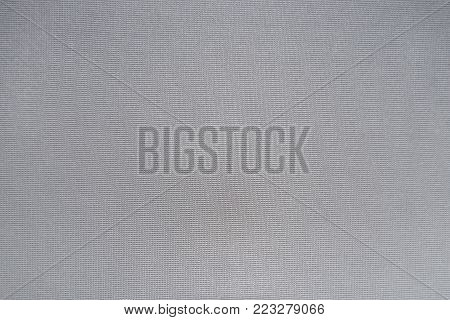 Light grey unprinted fabric texture from above