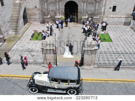 Arequipa, Peru March 2015 Urban scene outside a church in typical baroque style near the main square of the city