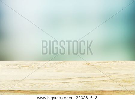 Wood table top on blurred abstract background - can be used for display or montage your products