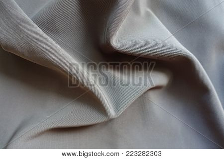 Crumpled dark grey viscose, cotton and polyester fabric