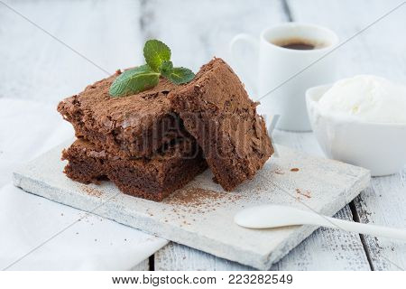 White isolated background with clipping paths homemade dark chocolate brownies and mint delicious bitter sweet and fudge. Brownie is one type of chocolate cake.Vintage tone.