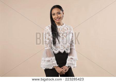 nice latina brunette girl standing isolated on studio background