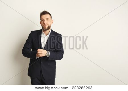 Handsome young smiling caucasian businessman studio shot on white isolated background. Confident man in formal clothes, copy space