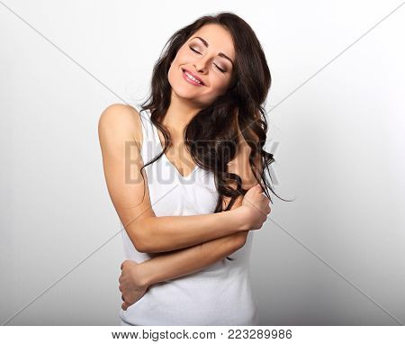 Happy Sporty Woman Hugging Herself With Natural Emotional Enjoying Face On White Background. Love Co