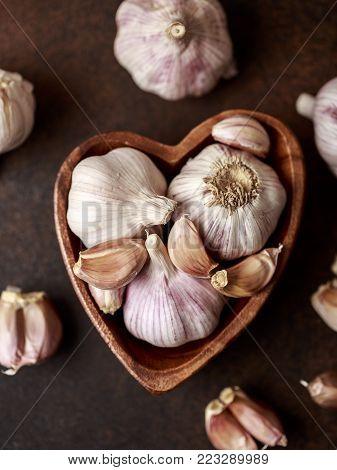 Fresh garlic on wooden background. Garlic bulbs