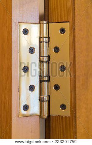 Door hinge yellow on the door close-up