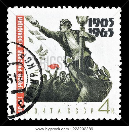 SOVIET UNION - CIRCA 1965 : Cancelled postage stamp printed by Soviet Union, that shows Demonstrator up on lamp post.