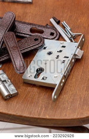 Door Lock With Keys Ready For Installation On Wooden Surface