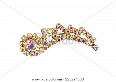 Old copper brooch with shiny scratched stones isolated on white background