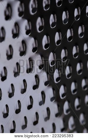 surface of metal graters as background. Photographed on a macro lens.